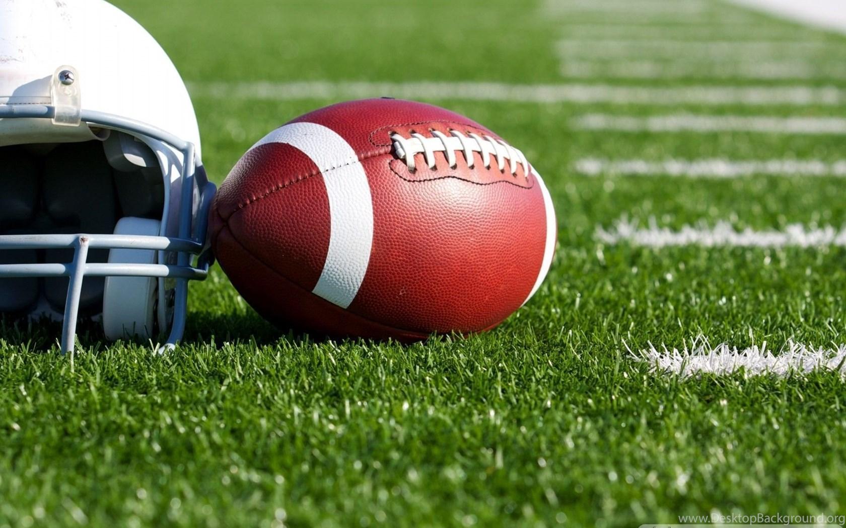 Football with Helmet on the Field.jpg Desktop Background