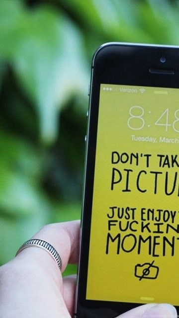 Get Off Your Phone! Artist Creates Hilarious Wallpapers For