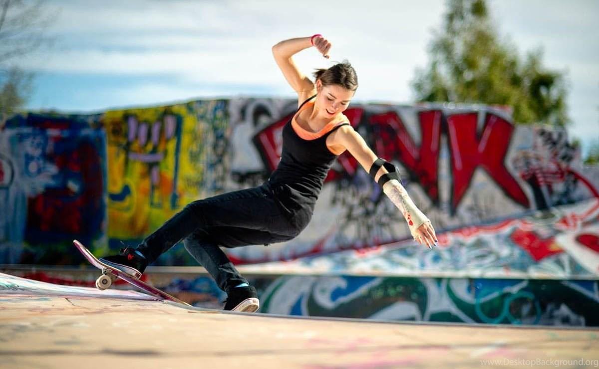 Skater girl skating on skate ground.jpg